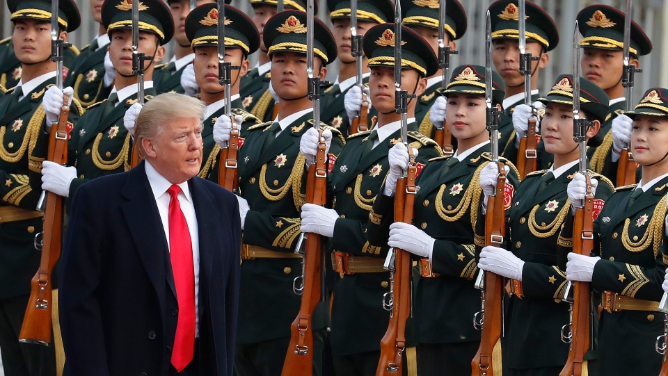 U.S. President Donald Trump reviews an honour guard with Chinese President Xi Jinping during a welcome ceremony at the Great Hall of the people in Beijing, Thursday, Nov. 9, 2017. (AP Photo/Andy Wong)