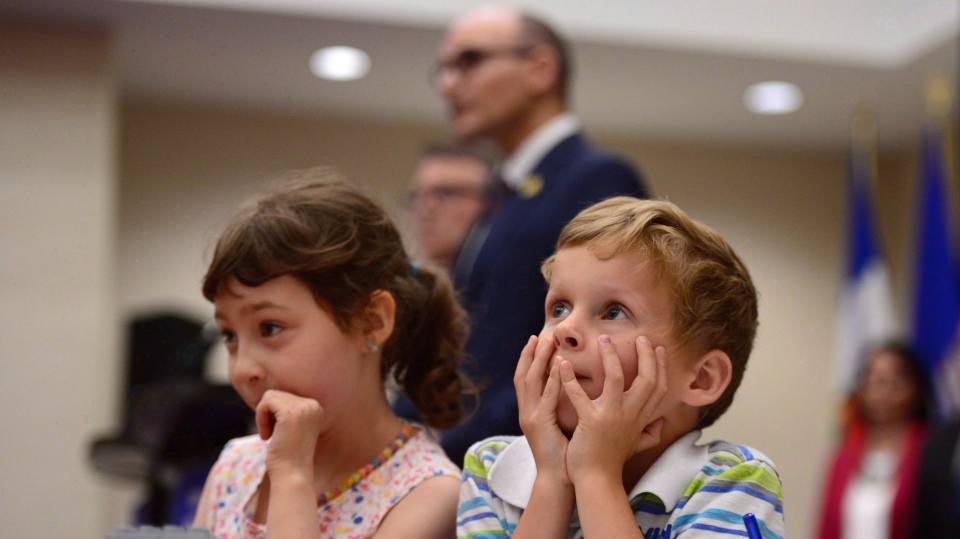 "Bryson Boyce-Pettes, 5, right, and Eleonore Alamillo-Laberge, 6, take part in a press conference as Social Development Minister Jean-Yves Duclos and P.E.I. Minister of Education, Doug Currie, speak as federal-provincial and territorial ministers responsible for ""Early Learning and Child Care"" meet in Ottawa on Monday, June 12, 2017. THE CANADIAN PRESS/Sean Kilpatrick"