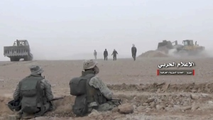Syrian pro-government troops are seen taking up positions during fighting with insurgents on the Iraq-Syria border in this image released Wednesday, Nov 8, 2017. (Syrian Central Military Media)