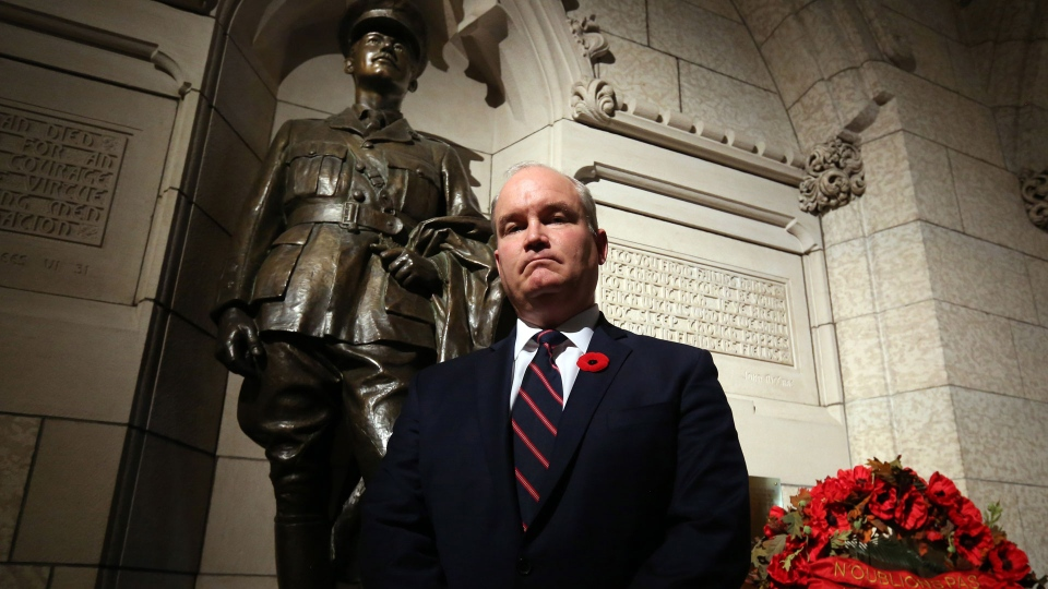 Conservative M.P. Erin O'Toole stands in front of a statue of Lieutenant-Colonel George Harold Baker the only sitting Member of Parliament killed in action during the First World War, on Parliament Hill, Wednesday, November 8, 2017, in Ottawa. THE CANADIAN PRESS/Fred Chartrand