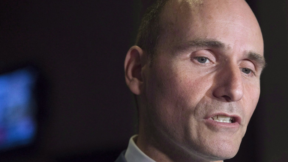 Jean-Yves Duclos, minister of Families, Children and Social Development, talks with reporters as the Liberal cabinet meets in St. John's on Sept. 13, 2017. (Andrew Vaughan / THE CANADIAN PRESS)