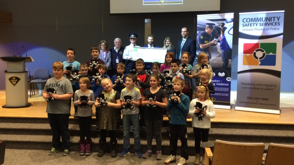 The Ontario Provincial Police, the OPP Youth Foundation and TD have together launched a new partnership that will enable OPP officers to continue the OPP Community Bear Program. (Krista Sharpe/CTV Barrie)