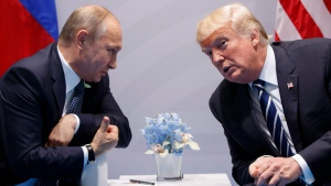 In this July 7, 2017, file photo, U.S. President Donald Trump meets with Russian President Vladimir Putin at the G-20 Summit in Hamburg. (AP Photo/Evan Vucci, File)