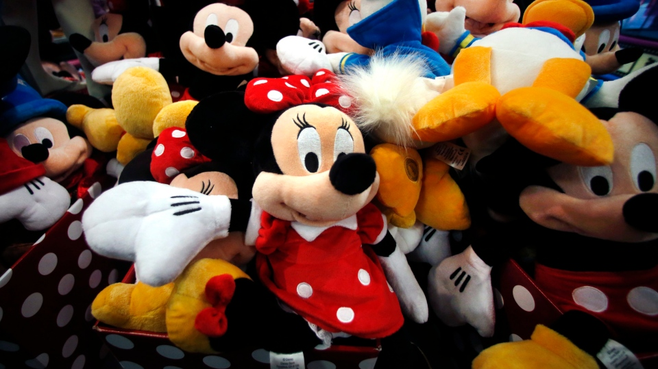 This Jan. 31, 2014, file photo shows plush Disney characters piled up in a display at a Disney Store in Saugus, Mass. (AP Photo/Elise Amendola, File)