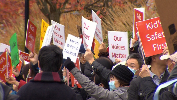 Marpole residents protesting a proposed modular housing project are seen outside Vancouver City Hall on Thursday, Nov. 9, 2017.
