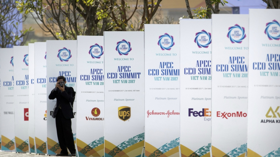 A photographer takes a photo outside the venue for the Asia-Pacific Economic Cooperation (APEC) CEO Summit in Danang, Vietnam on Thursday, Nov. 9, 2017. (AP / Mark Schiefelbein)