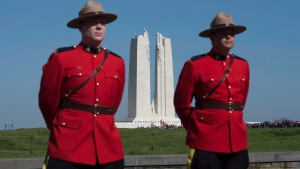 RCMP officers stand at the entrance to the Vimy Memorial before ceremonies to mark the 100th anniversary of the battle, north of Arras, France, Sunday, April 9, 2017. (THE CANADIAN PRESS / Adrian Wyld)