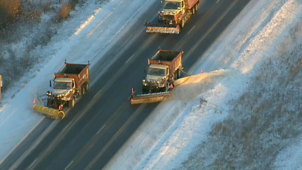 Snow plows and salt trucks covered outer Toronto roadways following the first snowfall of the season.