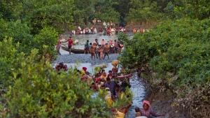 Groups of Rohingya Muslims cross the Naf river at the border between Myanmar and Bangladesh, near Palong Khali, Bangladesh, on Wednesday, Nov. 1, 2017. (Bernat Armangue/AP)