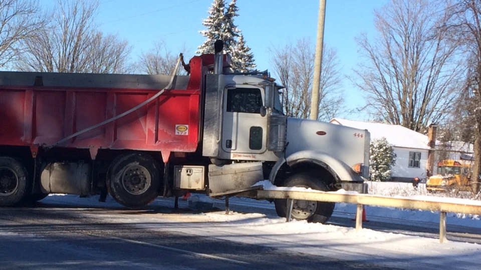 A dump truck crashed into the guardrail on Highway 11. (Rob Cooper/CTV Barrie)
