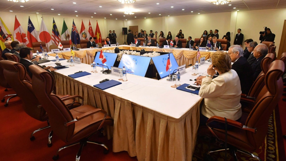 The empty seat, foreground, for Canada's Prime Minister Justin Trudeau, is seen during a meeting of the Trans-Pacific Partnership (TPP) on the sidelines of the Asia-Pacific Economic Cooperation (APEC) summit in Danang, Vietnam, Friday, Friday, Nov. 10, 2017. Efforts to reach an agreement this weekend on a Pacific Rim trade pact appeared to collapse Friday when persistent concerns over the deal, including Canada's, forced the abrupt cancellation of a scheduled leaders' meeting. THE CANADIAN PRESS/AAP Image via AP-Mick Tsikas