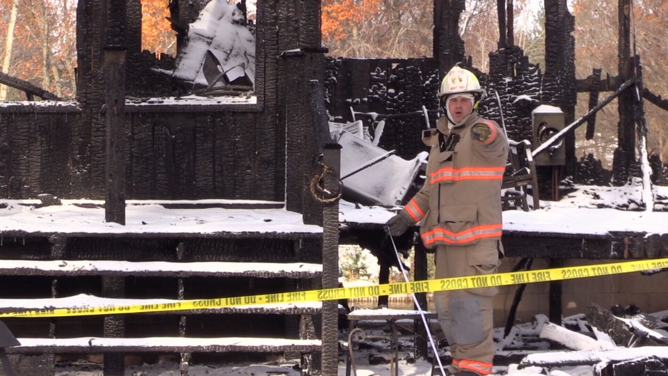 Investigators look into the cause of a house fire in Wasaga Beach on Nov. 10, 2017 (CTV Barrie)