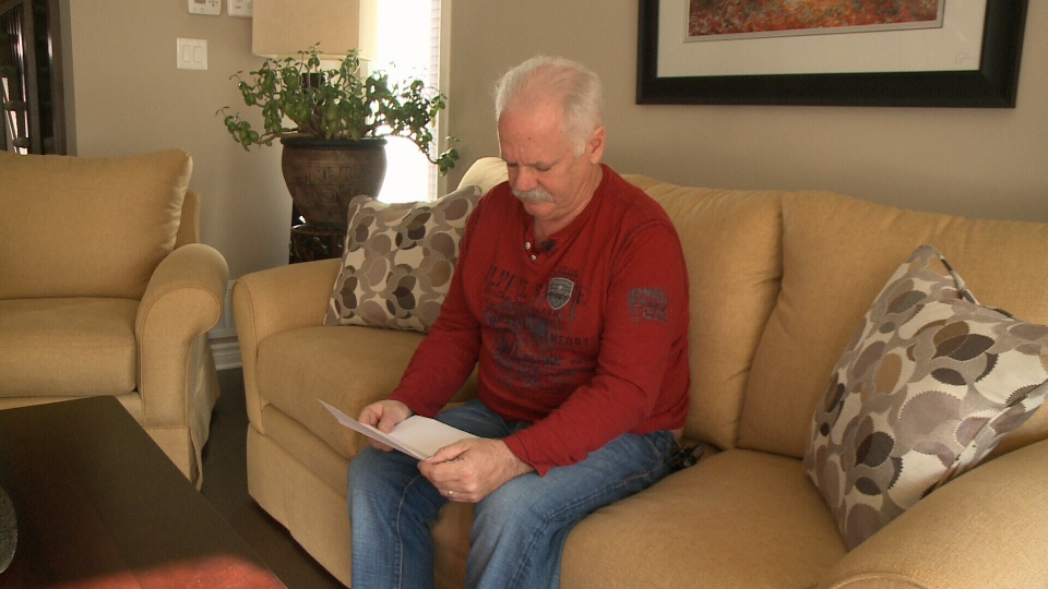 Fred Martin reads letter from his doctor.
