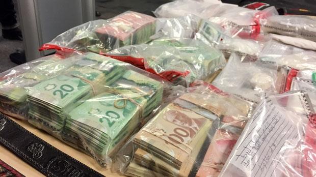 Police seized cash and drugs. (Jon Hendricks/CTV)