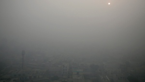 In this Friday, Nov. 10, 2017 file photo, the morning sun is enveloped by a blanket of smog on the outskirts of New Delhi, India. (AP Photo / Altaf Qadri, File)