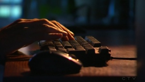A person typing on a computer is seen in this file image.
