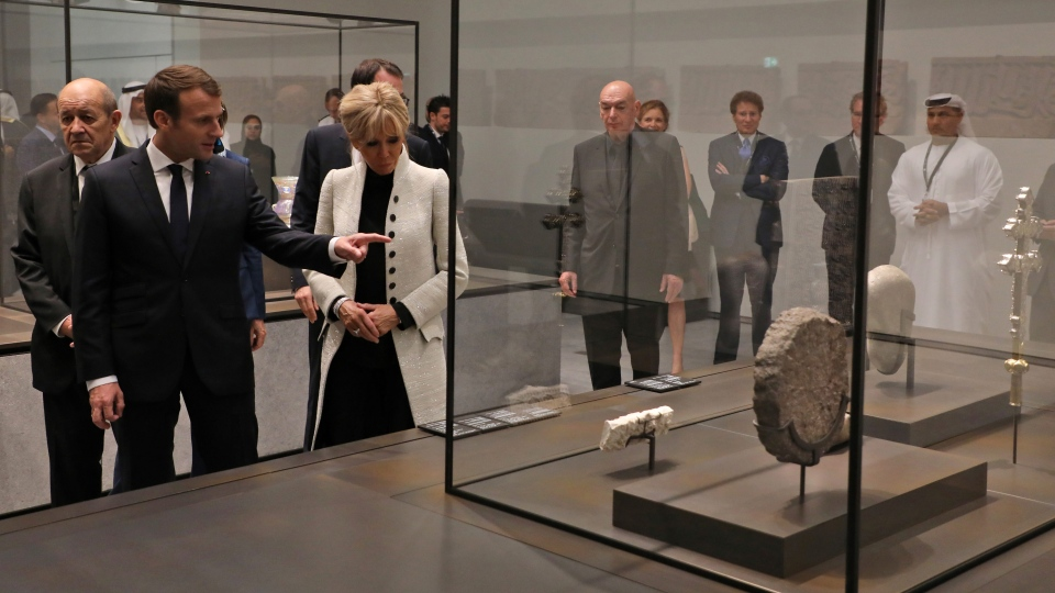 French President Emmanuel Macron, 2nd left, and his wife Brigitte Macron visit the Louvre Abu Dhabi Museum during its inauguration in Abu Dhabi, United Arab Emirates on Wednesday, Nov. 8, 2017. (Ludovic Marin/Pool photo via AP)