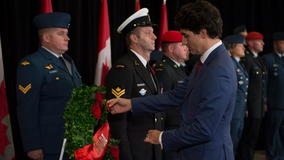 Canadian Prime Minister Justin Trudeau pins his poppy on a wreath during a Remembrance Day ceremony in Danang, Vietnam Saturday November 11, 2017. (THE CANADIAN PRESS/Adrian Wyld)