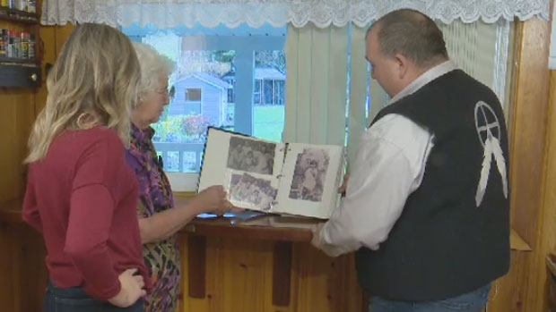 Bev and Jeff Purdy look at photographs of their great great grandfather.