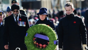 Minister of National Defence Harit Sajjan, left, Sophie Gregoire Trudeau and Minister of Veterans Affairs Seamus O'Regan place a wreath during Remembrance Day ceremonies at the National War Memorial in Ottawa on Saturday, Nov. 11, 2017. THE CANADIAN PRESS/Sean Kilpatrick
