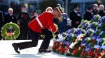 A soldier places a wreath during Remembrance Day ceremonies at the National War Memorial in Ottawa on Saturday, Nov. 11, 2017. (Sean Kilpatrick / THE CANADIAN PRESS)