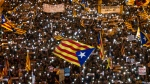 Demonstrators gather during a protest calling for the release of Catalan jailed politicians, in Barcelona, Spain, on Saturday, Nov 11, 2017. (AP Photo/Emilio Morenatti)