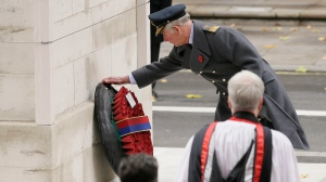 Prince Charles lays a wreath on behalf of Queen Elizabeth II during the service of remembrance at the Cenotaph in Whitehall, London, Sunday, Nov. 12, 2017. (AP / Tim Ireland)