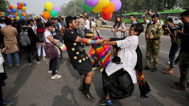 Two participants hold hands and dance as gay rights activists and their supporters march during a gay pride parade in New Delhi, India, Sunday, Nov. 12, 2017. (AP Photo)