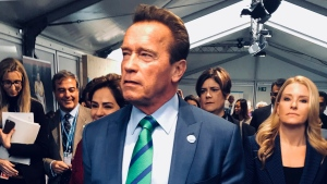 Film star and former California governor Arnold Schwarzenegger, front, arrives at the COP23 UN climate conference in Bonn, Germany, Sunday, Nov. 12, 2017. (AP Photo/Dorothee Thiesing)