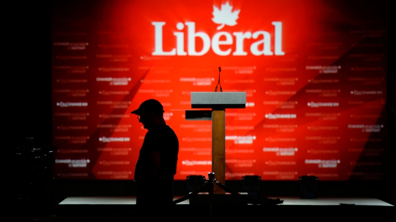 A camera operator waits for the start of Liberal leader Justin Trudeau's event in Montreal on October 19, 2015. (Justin Tang / THE CANADIAN PRESS)