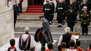 Britain's Prince Charles lays a wreath on behalf of Britain's Queen Elizabeth II during the service of remembrance at the Cenotaph in Whitehall, London, Sunday, Nov. 12, 2017. The annual service is to remember those who have lost their lives serving in the Armed Forces. (AP Photo/Tim Ireland)