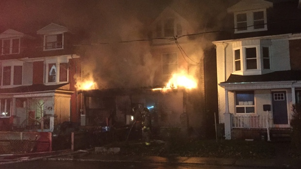 Investigators are looking into the cause of a fire at a home in Toronto's Junction Triangle neighbourhood late Sunday night. (Mike Nguyen/ CP24)