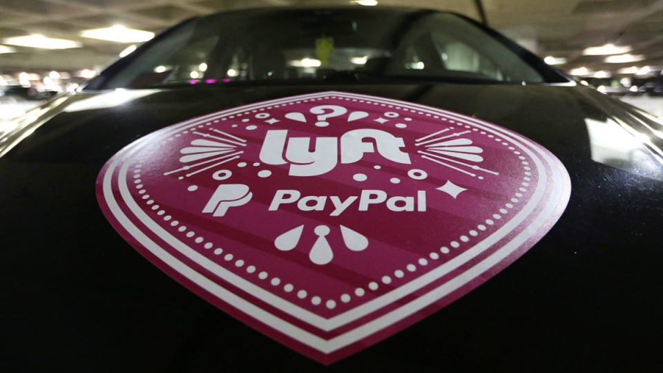 A vehicle with the logo from the Lyft ride sharing service is shown at Seattle-Tacoma International Airport, on March 31, 2016 in Seattle. (Ted S. Warren / THE CANADIAN PRESS / AP)