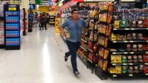 A shopper at a Walmart in Costa Rica makes his way towards the exit as the store rattles from a magnitude 6.5 earthquake on Sunday, Nov. 12, 2017. (Facebook/Oscar Ulloa via Storyful)