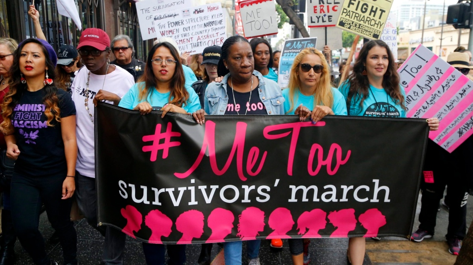 Participants march against sexual assault and harassment at the MeToo March in the Hollywood section of Los Angeles on Sunday, Nov. 12, 2017. (AP Photo/Damian Dovarganes)