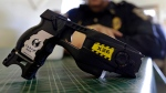 FILE - This Nov. 14, 2013, file photo, shows a Taser X26 on display. (AP Photo/Michael Conroy)