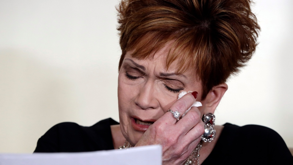 Beverly Young Nelson, the latest accuser of Alabama Republican Roy Moore, reads her statement at a news conference, in New York, Monday, Nov. 13, 2017. (AP Photo/Richard Drew)
