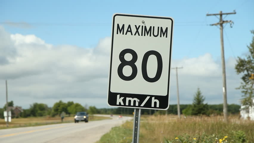 A road which has a posted speed limit of 80 kilometers per hour.