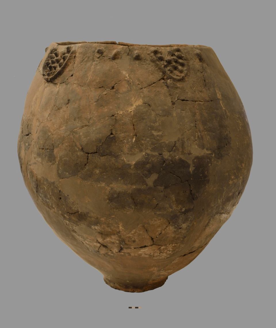 This undated photo provided by the National Museum of Georgia in November 2017 shows a Neolithic pottery vessel about 3 feet wide and 3 feet tall.  (National Museum of Georgia via AP)