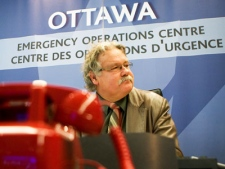 Chief Public Health Officer David Butler-Jones takes part in a meeting at the Public Health Agency's Emergency Operations Centre in Ottawa on Friday May 1, 2009. (Sean Kilpatrick  / THE CANADIAN PRESS)