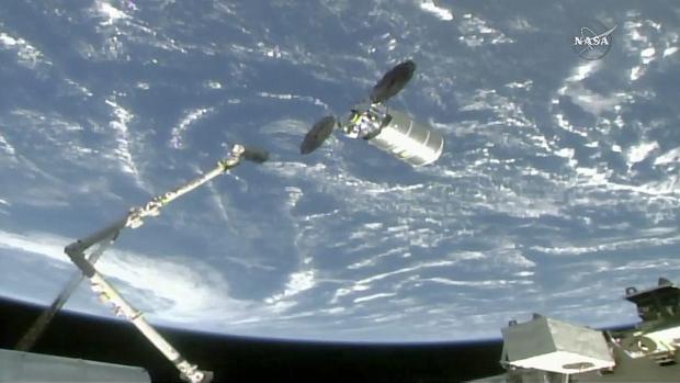 CanadArm reaches for the Cygnus cargo spacecraft
