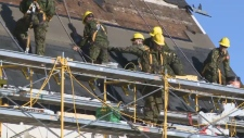 Military members replace roof