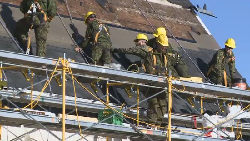 Members of the Canadian Armed Forces are replacing a decades-old roof on the former St. Alphonsus Church in an effort to help save the historic landmark.
