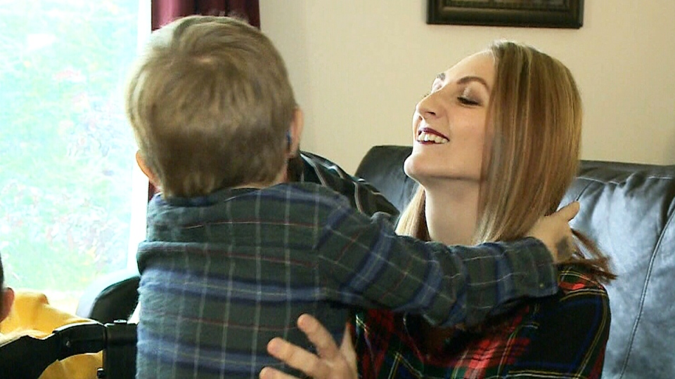 Stephanie Christiansen holds her 4-year-old son Hunter.