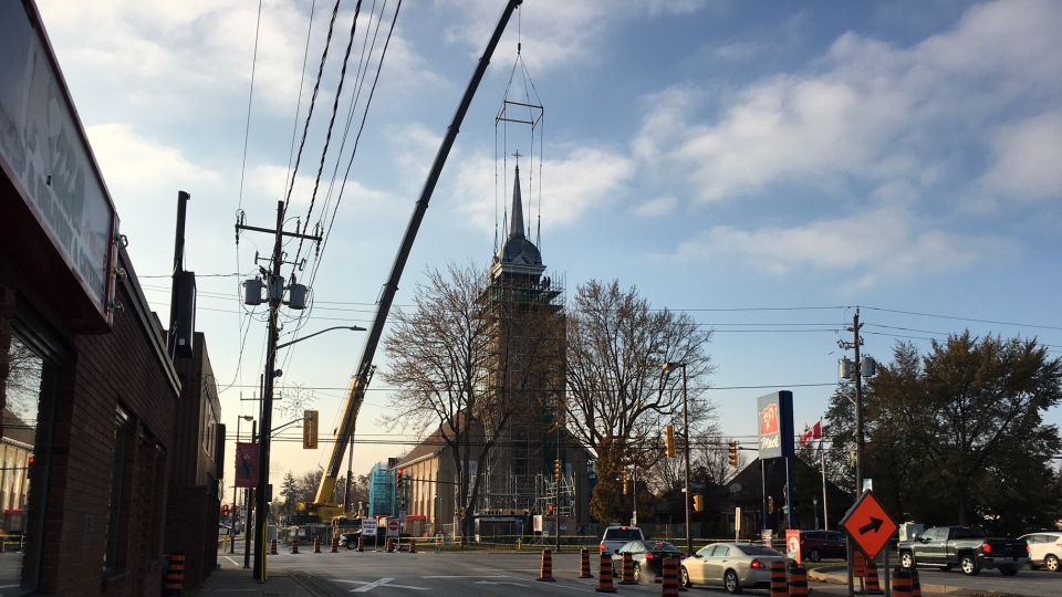 Crews are working to secure the spire on top of Ste. Anne Church in Tecumseh, Ont., on Tuesday, Nov. 14, 2017. (Melanie Borrelli / CTV Windsor)