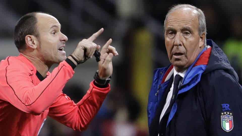 Referee Antonio Mateu Lahoz gestures when talking to Italy coach Gian Piero Ventura during the World Cup qualifying match at the Milan San Siro stadium, Italy, on Nov. 13, 2017. (Luca Bruno / AP)