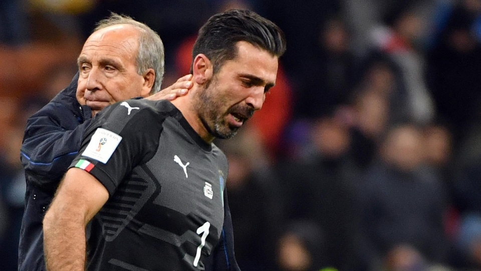 Italy coach Gian Piero Ventura, left, consoles Gianluigi Buffon at the end of the World Cup qualifying loss to Sweden, at the San Siro stadium in Milan, Italy, on Nov. 13, 2017. (Daniel Dal Zennaro / ANSA via AP)