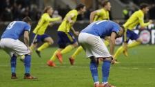 Italian players react to their elimination