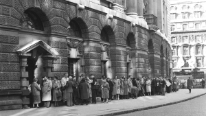 In this B/W file photo dated Oct. 27, 1960, a queue forms outside The Old Bailey Central Criminal Court, in London, for admission to the public gallery where the 'Lady Chatterley's Lover' case is resuming. (AP Photo, FILE)