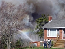 Smoke nears a Spryfield, N.S. home near Halifax on Friday, May 1, 2009. (Kaylie VanBuskirk / MyNews.CTV.ca)
